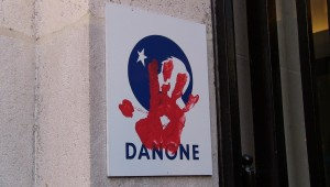 Via Campesina protesters put their red hand print on Danone's logo expressing their demand that the company stop affecting campesinos worldwide. | Photo: teleSUR
