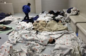 Detainees sleep in a holding cell at the US Customs and Border Protection Facility in Brownsville, Texas (Reuters/Eric Gay)